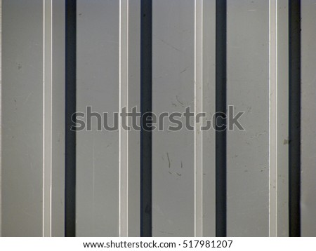 Grey color painted corrugated iron sheet close up for background.