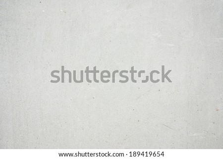 Grey concrete texture wall, bright white background - stock photo