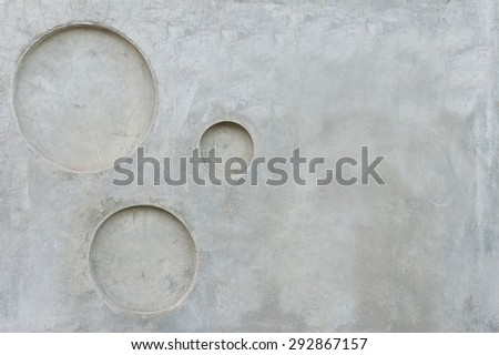 grey concrete wall with circle pitted texture background