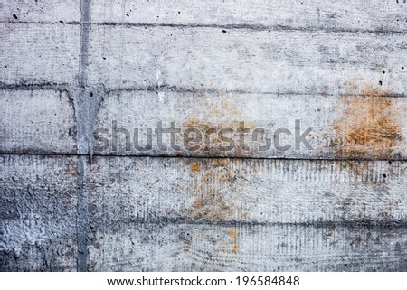 Grey concrete wall with hardened traces of the shuttering moulds - stock photo