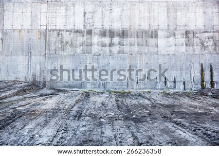 Grey concrete wall with the hardened traces of the shuttering moulds - stock photo