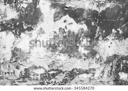 Grey cracked peeled wall surface texture background. - stock photo