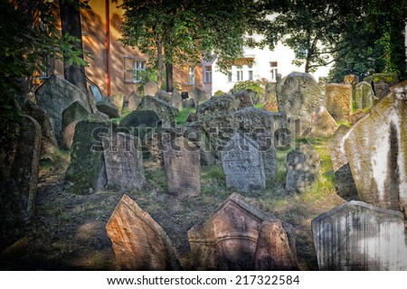 Grey crowded tombstones in the Old Jewish Cemetery in Prague - stock photo