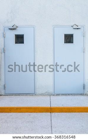 grey door metal in warehouse - stock photo