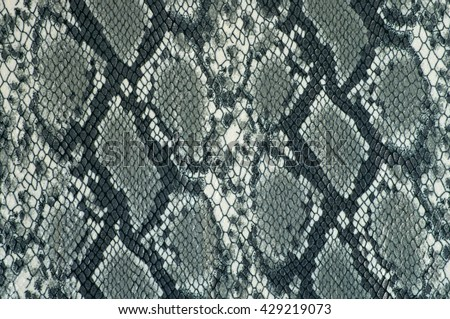 Grey fabric background close up with animal print