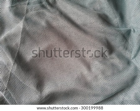 grey fishnet fabric texture useful as a background - stock photo