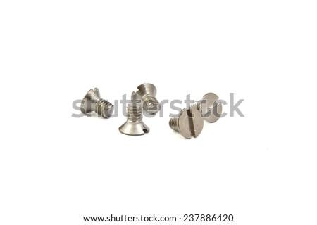 Grey flat screw on bright background - stock photo