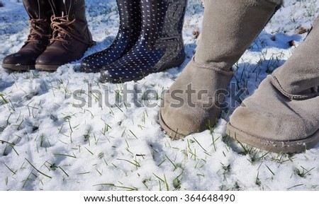 Grey fuzzy sheepskin boots in the winter snow