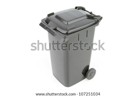 Grey garbage wheelie bin with a closed lid on a white background. - stock photo
