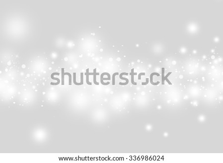 Grey glitter sparkles defocused rays lights bokeh abstract christmas background.