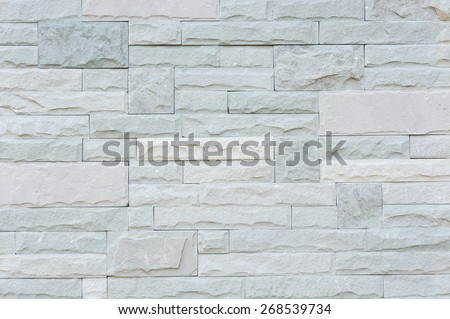 Grey granite stone brick on the wall background