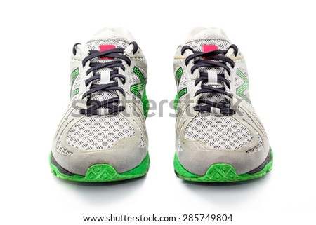 Grey green running shoes isolated on white - stock photo