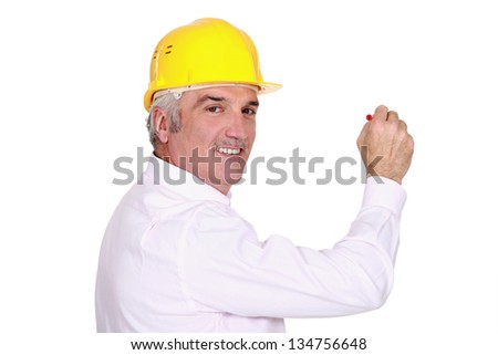Grey haired architect with pen - stock photo