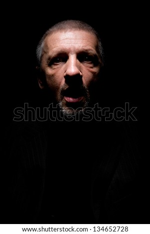 Grey haired mature man with opened mouth and scaring look - stock photo