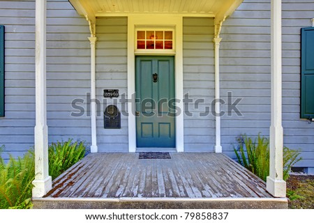 Grey house Entrance with green door. Amazing home from 1856 has never been touched since then. All details remain original. Lakewood, Washington State, US. - stock photo