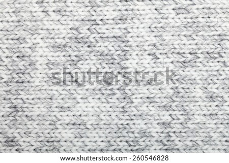 Grey knitted fabric made of heathered yarn textured background - stock photo