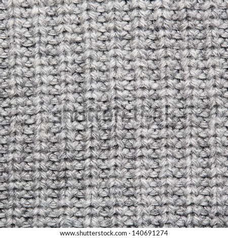 Grey knitted wool close up