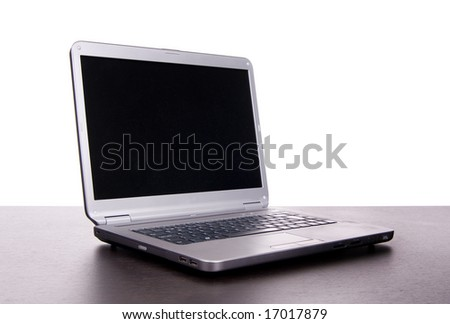 grey laptop at desk isolated on white