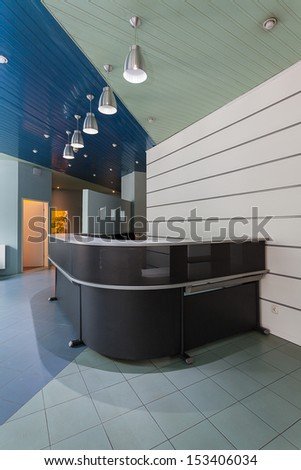 Grey modern counter on an entrance to company - stock photo
