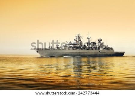 Grey modern warship sailing in still water  - stock photo