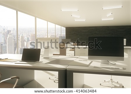 Grey office workspace with blank laptop and computer screen. 3D Rendering