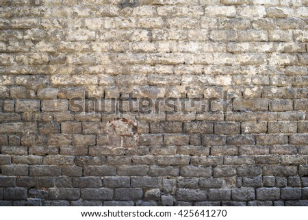 Grey old brick wall background