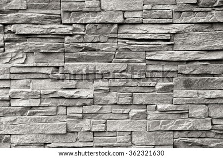 Grey pattern of decorative brown grey slate stone wall surface - stock photo