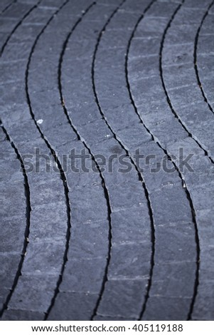 Grey pavement waves shape handmade sidewalk closeup - stock photo