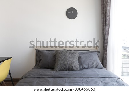 grey pillows on bed - stock photo