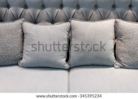 grey pillows on matched grey sofa