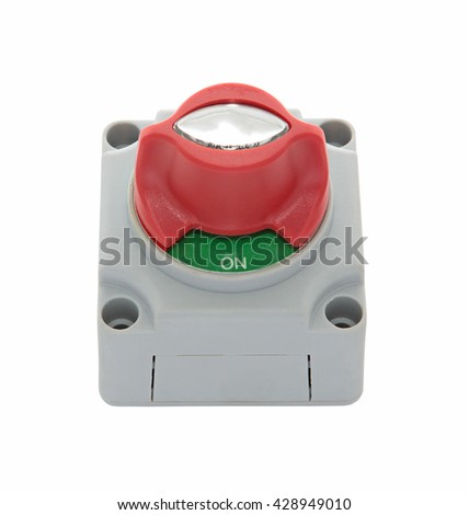 Grey, red and green plastic boat electrical disconnect switch with screw holes, upper front view, isolated on white - stock photo