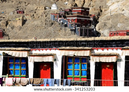 Grey-red-white painted buildings of the 1073 AD.northern temple of the Sakya-Grey Soil monastery on the slope of Ponpori Hill over the right bank of Chong Chu-river. Sakya-Shigatse pref.-Tibet.