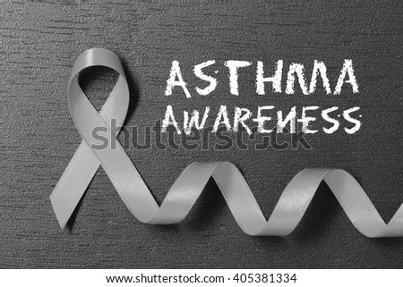 Grey ribbon. Asthma awareness. healthcare and medicine concept. - stock photo