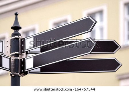 Grey road sign in the city. - stock photo