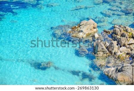 grey rocks in Capo Testa clear water, Sardinia - stock photo
