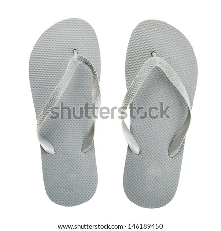 Grey rubber flip-flops isolated over white background, pair shot above - stock photo