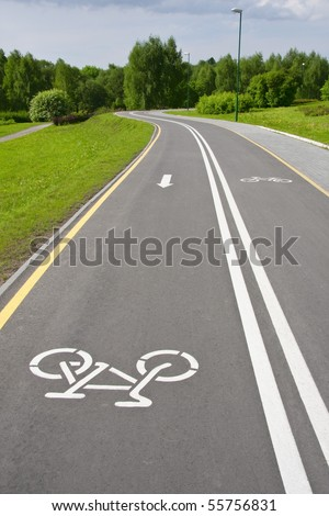 grey sinuous bicycle path in the park - stock photo