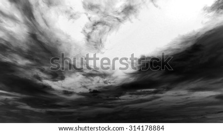 Grey sky with white and black clouds - stock photo