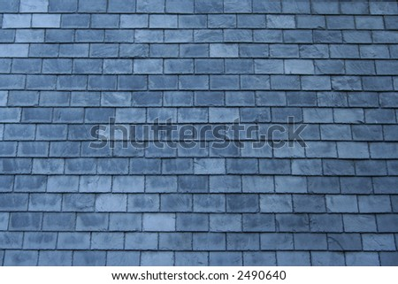 grey slate tiles background on side of building
