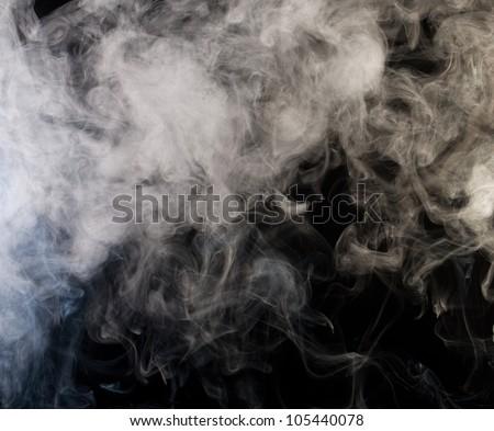 grey smoke on a black background - stock photo