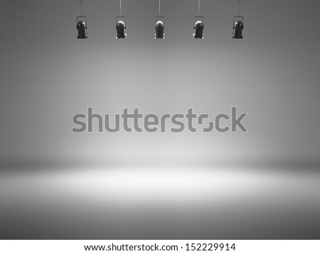 grey spotlight background with lamps - stock photo