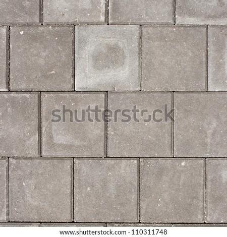 Grey square pavement tiles. Texture background. - stock photo