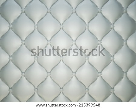 Grey stitched leather pattern with buttons and bumps. Luxury background - stock photo