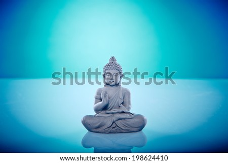 Grey stone buddah Wellness and Spa Image, works perfect for advertising Health and Beauty, Spirituality or Massage. - stock photo