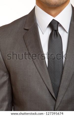 grey suit with black tie