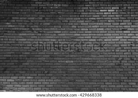Grey textured wall, dark edges - stock photo