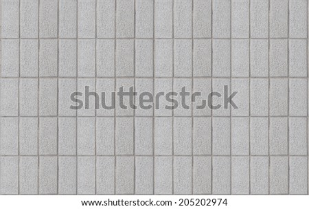 Grey tile wall - stock photo