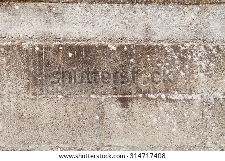 Grey wall of cement blocks damaged by the passage of time - stock photo