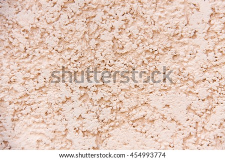 grey wall with decorative plaster as a background - stock photo