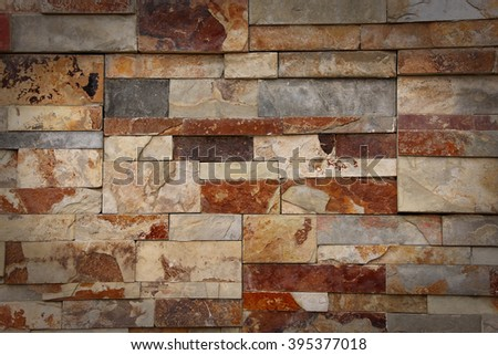 Grey, white and brown granite brick wall and black vignette - stock photo